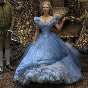 Lily James portraying the character of Cinderella. Going into the palace for the ball