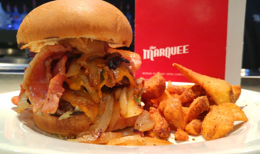 Kris' Smooth Operator Burger - 2 beef patties, caramelized onions, cheddar cheese, peanut butter, and lots of bacon.