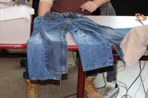 Sustainability coordinator Wai Chu Cheng says jeans are easy to fix, and are one of the most commonly brought in items. (Photos by Matthew Burditt/The Sheridan Sun)
